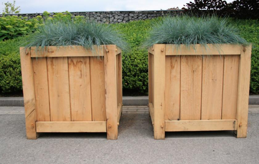 Stijlvolle blikvanger in de tuin de houten plantenbak for Vijverrand maken
